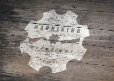 Painted wood logo of local machine shop business.